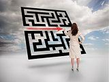 Businesswoman drawing red arrow through qr code