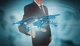 Businessman touching futuristic world map interface