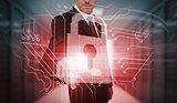 Businessman touching futuristic lock and circuit board interface