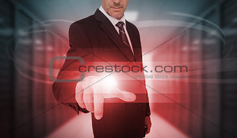 Businessman touching futuristic red light touchscreen
