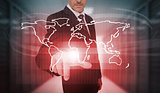 Businessman pressing red world map interface