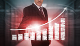 Businessman pressing red chart and arrow interface