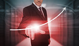 Businessman pressing red growth arrow interface