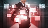 Businessman selecting futuristic flowchart interface