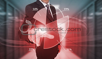 Businessman selecting futuristic pie chart interface