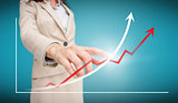 Businesswoman touching futuristic red and white graph with arrows