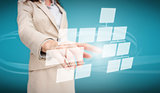 Businesswoman touching futuristic flow chart interface