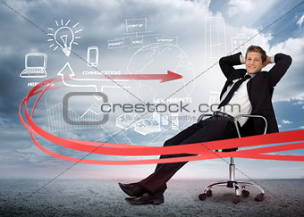 Businessman sitting in front of brainstorming drawings
