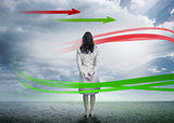 Businesswoman looking at red and green arrows