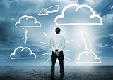 Businessman considering cloud computing graphics