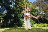 Mother swinging her daughter around having fun