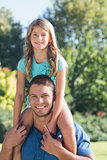 Girl sitting on her dads shoulder
