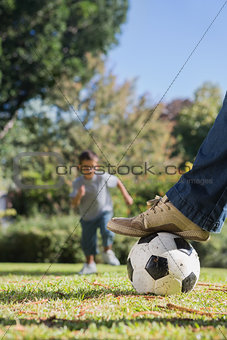 Boy running towards the football