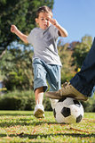 Boy kicking the football
