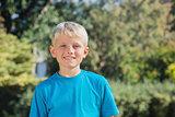 Blonde boy smiling at camera