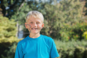 Blonde boy smiling at camera