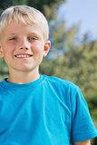 Little blonde boy smiling at camera