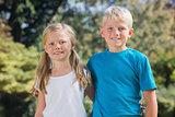 Brother and sister smiling at camera