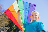 Boy having fun with a kite