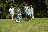 Happy multi generation family playing football