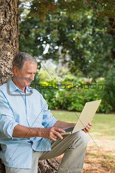 Old man looking at his laptop