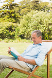 Happy mature man reading book