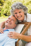 Happy mature couple smiling at camera