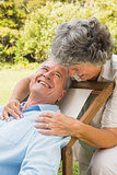 Happy mature woman smiling at her husband