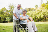 Mature woman in wheelchair with partner