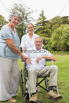 Man in wheelchair and his wife and nurse