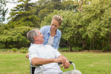 Man in wheelchair and daughter talking