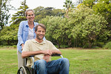 Smiling man in wheelchair with partner