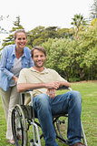 Happy man in wheelchair with partner