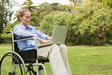 Young woman in a wheelchair with a laptop