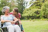 Granddaughter hugging grandmother in wheelchair