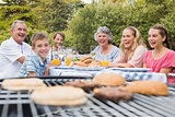Laughing family having a barbecue in the park together