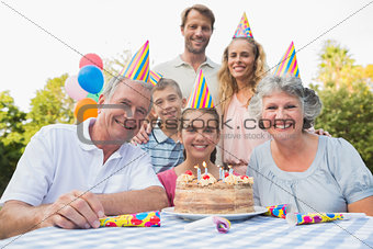 Cheeful family smiling at camera at birthday party