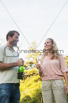 Beautiful couple having champagne together