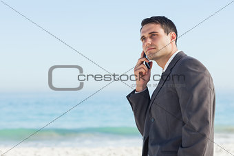 Pensive businessman on the phone