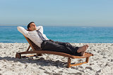 Young businessman relaxing on a deck chair