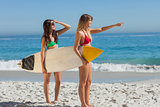 Two gorgeous women going to surf