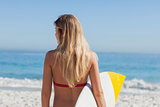 Gorgeous blond woman going to surf