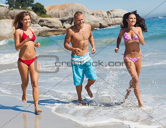 Friends jogging on the beach