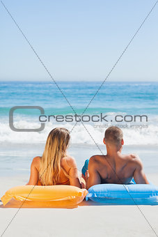 Cute couple in swimsuit taking sun