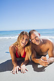Smiling cute couple in swimsuit posing