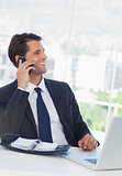 Cheerful businessman having a phone call