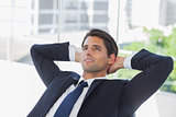 Thoughtful businessman with hands on head