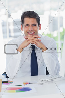 Smiling businessman posing crossing fingers