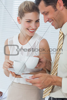 Attractive businesswoman laughing with her colleague