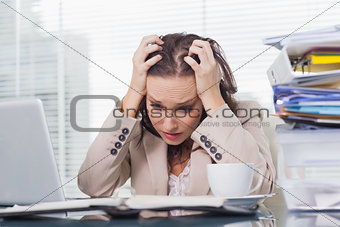 Nervous businesswoman pulling her hair out